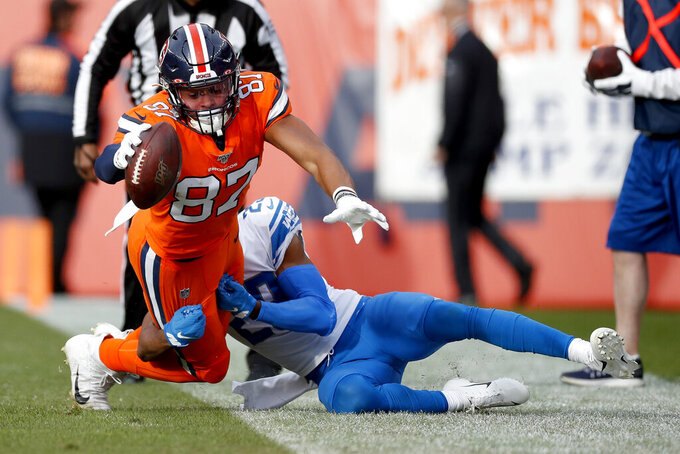 Denver Broncos tight end Noah Fant (87) reaches as he is knocked out of bounds by Detroit Lions cornerback Darius Slay during the first half of an NFL football game, Sunday, Dec. 22, 2019, in Denver. (AP Photo/David Zalubowski)