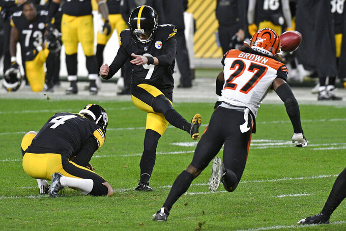 Pittsburgh Steelers kicker Chris Boswell (9) boots a 40-yard field goal during the first half of an NFL football game against the Cincinnati Bengals in Pittsburgh, Sunday, Nov. 15, 2020. (AP Photo/Don Wright)