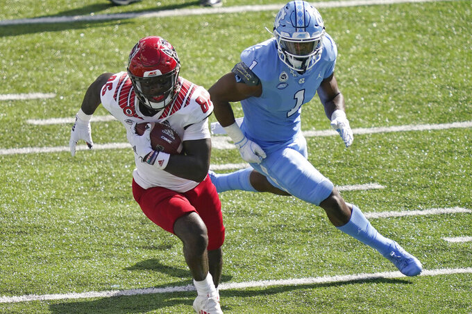North Carolina State wide receiver Emeka Emezie (86) runs the ball while North Carolina defensive back Kyler McMichael (1) chases during the first half of an NCAA college football game in Chapel Hill, N.C., Saturday, Oct. 24, 2020. (AP Photo/Gerry Broome)