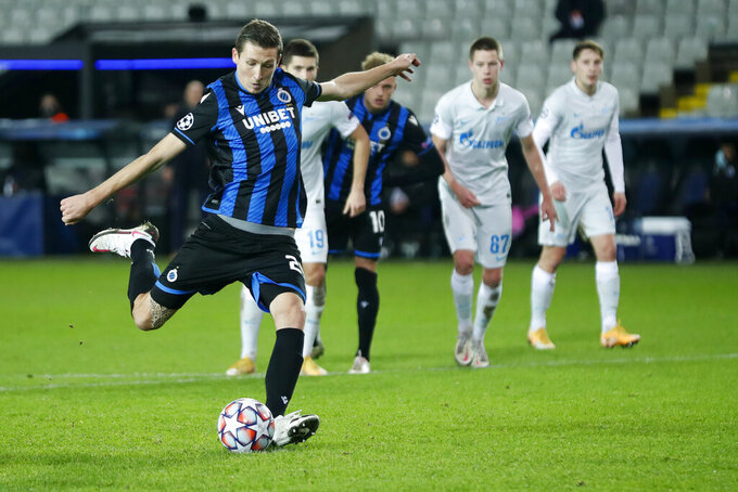 Brugge's Hans Vanaken on his way to scoring his sides second goal on a penalty during a Champions league Group F soccer match between Brugge and Zenit at the Jan Breydel stadium in Bruges, Belgium, Wednesday, Dec. 2, 2020. (AP Photo/Francisco Seco)