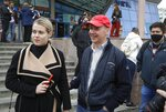 In this picture taken on Wednesday, May 26, 2020, Valery Tsepkalo, a potential candidate in the upcoming presidential election, smiles as his wife Veronica looks on in Minsk, Belarus. The central elections commission in Belarus has rejected a top challenger's bid to run against authoritarian President Alexander Lukashenko in this summer's election. Tsepkalo, a former ambassador to the United States and a founder of a successful high-technology park, submitted 160,000 signatures on petitions to get on the ballot for the Aug. 9 election, but the commission said only 75,000 were valid less than the 100,000 needed. (AP Photo/Sergei Grits)