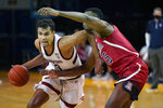 FILE - In this Dec. 19, 2020, file photo, Stanford forward Oscar da Silva, left, drives against Arizona center Christian Koloko during the second half of an NCAA college basketball game in Santa Cruz, Calif. Oscar da Silva is a member of The AP All-Pac-12 first team, announced Tuesday, March 9, 2021. (AP Photo/Jeff Chiu, File)