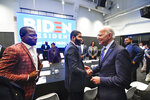 Former Vice President and 2020 Democratic presidential candidate Joe Biden, right, walks around a table meeting with an assembly of Southern black mayors including Mississippi Mayor Chokwe Lumumba and Virginia Mayor Levar Stoney, left, Thursday, Nov. 21, 2019 in Atlanta. (AP Photo/John Amis)