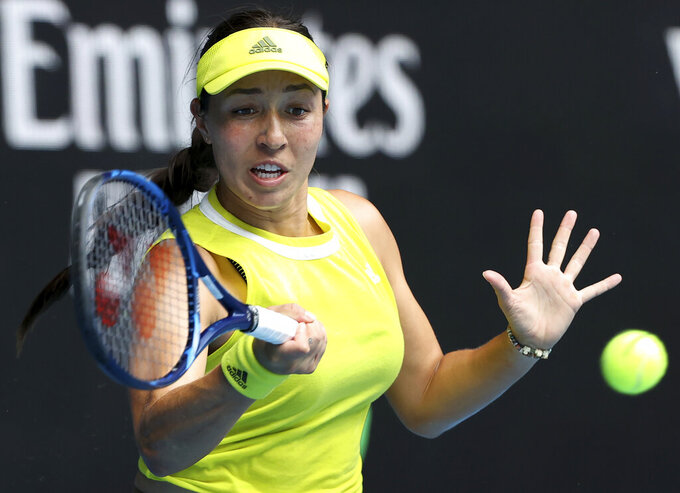 United States' Jessica Pegula hits a forehand to France's Kristina Mladenovic during their match at the Australian Open tennis championships in Melbourne, Australia, Saturday, Feb. 13, 2021. (AP Photo/Hamish Blair)
