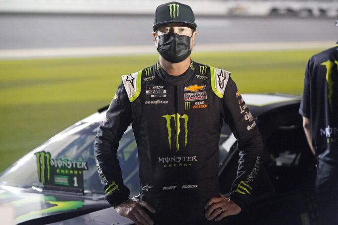 Kurt Busch stands by his car on pit road during qualifying for the NASCAR Daytona 500 auto race at Daytona International Speedway, Wednesday, Feb. 10, 2021, in Daytona Beach, Fla. (AP Photo/John Raoux)