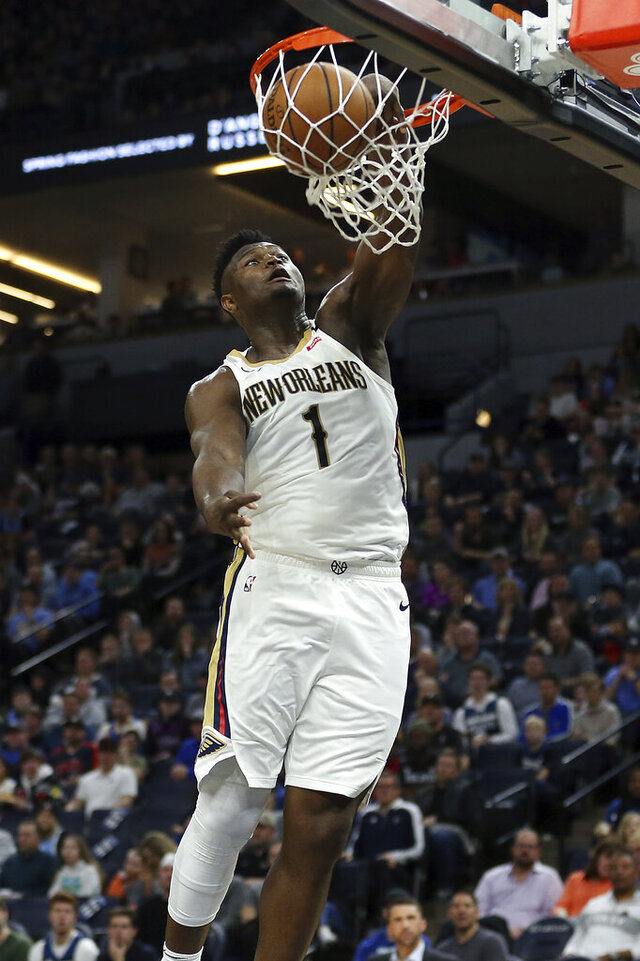"""FILE - New Orleans Pelicans' Zion Williamson dunks in the second half of an NBA basketball game against the Minnesota Timberwolves in Minneapolis, in this Sunday, March 8, 2020, file photo. Williamson expects to unleash a version of himself that is healthier, more demonstrative and less restrained in his second NBA season with the Pelicans. """"Year 1 was a lot mentally and physically for me, but I needed that experience,"""" Williamson said Wednesday, Dec. 2, as the Pelicans underwent preparations for training camp.  (AP Photo/Stacy Bengs, File)"""