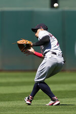 Cleveland Indians second baseman Cesar Hernandez cannot make the catch on a hit by Oakland Athletics' Matt Chapman during the sixth inning of a baseball game Saturday, July 17, 2021, in Oakland, Calif. Chapman was safe at first base. (AP Photo/Tony Avelar)
