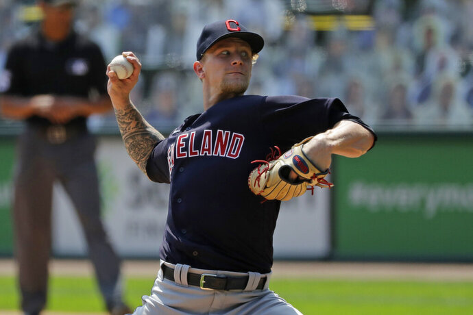 Cleveland Indians starting pitcher Zach Plesac throws against the Chicago White Sox during the first inning of a baseball game in Chicago, Saturday, Aug. 8, 2020. (AP Photo/Nam Y. Huh)
