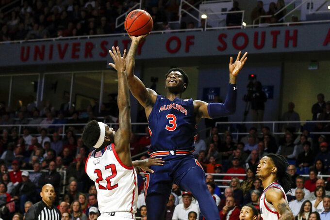 Auburn forward Danjel Purifoy (3) puts up a shot over South Alabama guard Andre Fox (22) during the second half of an NCAA college basketball game, Tuesday, Nov. 12, 2019, in Mobile, Ala. Auburn won 70-69. (AP Photo/Butch Dill)