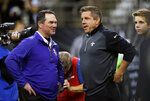 FILE - In this Sept. 21, 2014, file photo, Minnesota Vikings head coach Mike Zimmer, left, and New Orleans Saints head coach Sean Payton talk before an NFL football game, in New Orleans. The Saints and Vikings play in a divisional playoff game on Sunday, Jan. 14, 2018, in Minneapolis. (AP Photo/Bill Haber, File)