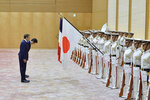 French President Emmanuel Macron, rear, and Japanese Prime Minister Shinzo Abe review an honor guard prior to their meeting at Abe's official residence, Wednesday, June 26, 2019, in Tokyo. Macron will attend the G20 Osaka Summit which will be held on June 28th and 29th in Osaka. (David Mareuil/Pool Photo via AP)