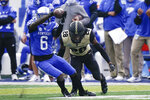 Kentucky wide receiver Josh Ali (6) catches the ball as he is tackled by Vanderbilt cornerback Allan George (28) during the first half of an NCAA college football game, Saturday, Nov. 14, 2020, in Lexington, Ky. (AP Photo/Bryan Woolston)