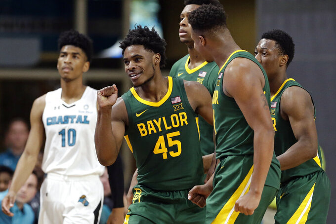 Baylor guard Davion Mitchell (45) gestures following a play against Coastal Carolina during the second half of an NCAA college basketball game at the Myrtle Beach Invitational in Conway, S.C., Friday, Nov. 22, 2019. (AP Photo/Gerry Broome)