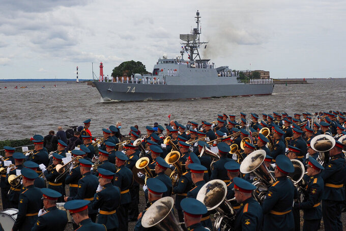 """Iranian frigate """"Sahand"""" of the Southern Fleet of the Islamic Republic of Iran Navy takes part in the military parade during celebrations for Navy Day, in Kronshtadt outside St.Petersburg, Russia, Sunday, July 25, 2021. (AP Photo)"""