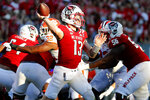 North Carolina State's Devin Leary (13) passes the ball against Clemson during the second half of an NCAA college football game in Raleigh, N.C., Saturday, Sept. 25, 2021. (AP Photo/Karl B DeBlaker)