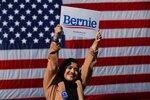 A woman attends a rally for Democratic presidential candidate Sen. Bernie Sanders, I-Vt., on Saturday, Oct. 19, 2019 in New York. (AP Photo/Eduardo Munoz Alvarez)