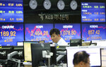 A currency trader watches monitors at the foreign exchange dealing room of the KEB Hana Bank headquarters in Seoul, South Korea, Thursday, May 17, 2018. Asian stocks were mixed on Thursday after strong factory data from the U.S. helped spur gains overnight on Wall Street. (AP Photo/Ahn Young-joon)