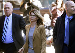 Actress Lori Loughlin arrives at federal court in Boston on Wednesday, April 3, 2019, to face charges in a nationwide college admissions bribery scandal. (AP Photo/Steven Senne)