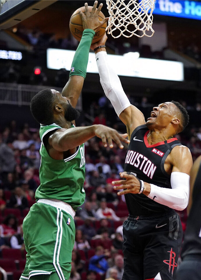 Houston Rockets' Russell Westbrook, right, has his shot blocked by Boston Celtics' Jaylen Brown during the first half of an NBA basketball game Tuesday, Feb. 11, 2020, in Houston. (AP Photo/David J. Phillip)