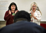 Carmen Mandley, left, and Stephanie Shine with the Tennessee Shakespeare Company react to a spontaneous bow while working on a speech project with juveniles being house at Jail East on Aug. 14, 2019 in Memphis. The Tennessee Shakespeare Company has recently received a grant to work with juveniles in Shelby County Juvenile Court. (Jim Weber/Daily Memphian via AP)