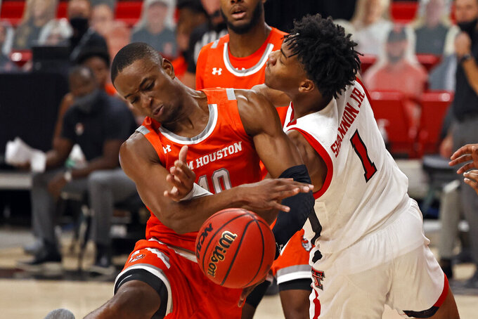 Sam Houston State's Zach Nutall (10) and Texas Tech's Terrence Shannon Jr. (1) try to rebound the ball during the first half of an NCAA college basketball game Friday, Nov. 27, 2020, in Lubbock, Texas. (AP Photo/Brad Tollefson)