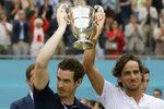 Andy Murray of Britain, left, celebrates with Feliciano Lopez of Spain after winning their men's doubles final tennis match against Joe Salisbury of Britain and the Rajeev Ram of the United States at the Queens Club tennis tournament in London, Sunday June 23, 2019. (AP Photo/Tim Ireland)