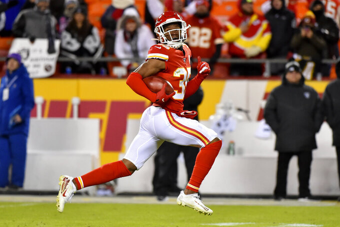 Kansas City Chiefs cornerback Charvarius Ward (35) looks back as he runs for a safety after an Oakland Raiders blocked extra point-attempt in the second half of an NFL football game in Kansas City, Mo., Sunday, Dec. 1, 2019. (AP Photo/Ed Zurga)