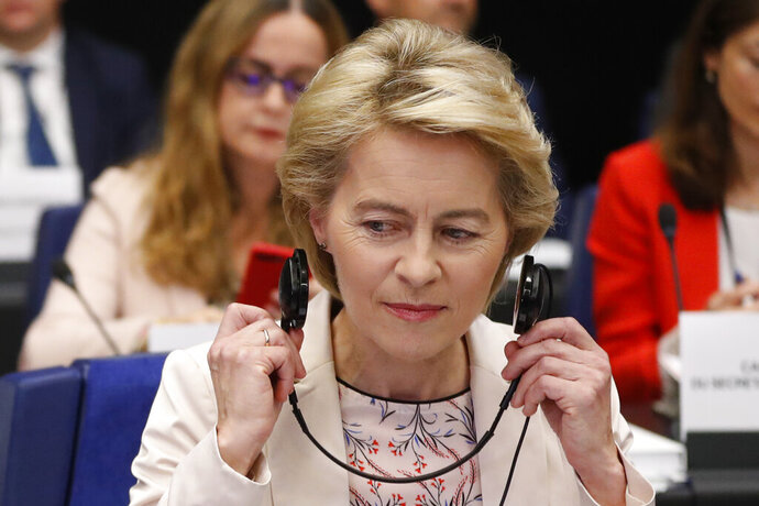 Incoming European Commission President Ursula von der Leyen adjusts her earphones Thursday, Sept. 19, 2019 at the European Parliament in Strasbourg, eastern France. The European Parliament Conference of Presidents holds an exchange of views with European Commission President-elect Ursula von der Leyen and approve the detailed schedule for the hearings of Commissioners-designate (AP Photo/Jean-Francois Badias)