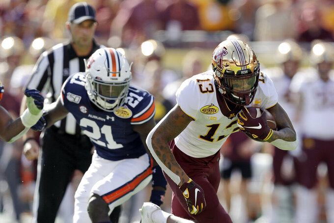 FILE - In this Jan. 1, 2020, file photo, Minnesota wide receiver Rashod Bateman (13) turns upfield against Auburn during the first half of the Outback Bowl NCAA college football gam in Tampa, Fla. Baltimore ranked last in the NFL averaging 171.2 yards passing per game and had the fewest pass attempts with 406 last season. That's partly because the running game was so proficient behind quarterback Lamar Jackson, the catalyst for the league's No. 1 rushing attack (191.9 yards per game) for the second straight season. (AP Photo/Chris O'Meara, File)