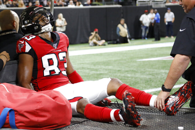 Atlanta Falcons wide receiver Russell Gage (83) is taken off the field after injury against the New York Jets during the first half an NFL preseason football game, Thursday, Aug. 15, 2019, in Atlanta. (AP Photo/Andrea Smith)