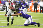 Atlanta Falcons running back Devonta Freeman, left, is tackled by Minnesota Vikings outside linebacker Anthony Barr, right, during the second half of an NFL football game, Sunday, Sept. 8, 2019, in Minneapolis. (AP Photo/Bruce Kluckhohn)
