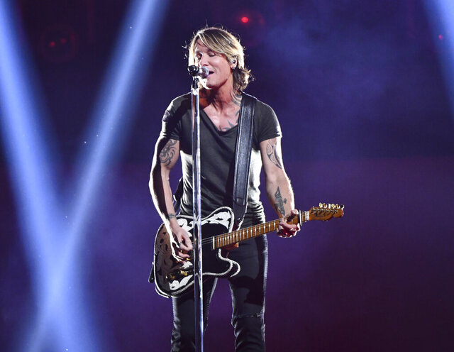 FILE - This Nov. 14, 2018 file photo shows Keith Urban performing at the 52nd annual CMA Awards in Nashville, Tenn. Urban's latest album