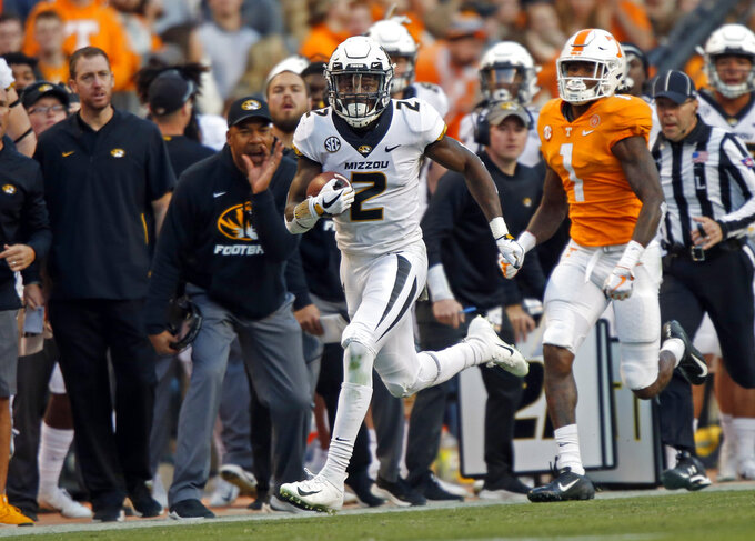 Missouri defensive back DeMarkus Acy (2) returns an interception intended for Tennessee wide receiver Marquez Callaway (1) in the first half of an NCAA college football game Saturday, Nov. 17, 2018, in Knoxville, Tenn. (AP Photo/Wade Payne)