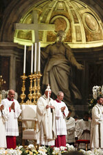 Pope Francis presides over a solemn Easter vigil ceremony in St. Peter's Basilica at the Vatican, Saturday, April 21, 2019. (AP Photo/Gregorio Borgia)