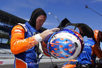 Scott Dixon, of New Zealand, takes off his helmet following the final practice session for the Indianapolis 500 auto race at Indianapolis Motor Speedway, Friday, Aug. 21, 2020, in Indianapolis. (AP Photo/Darron Cummings)