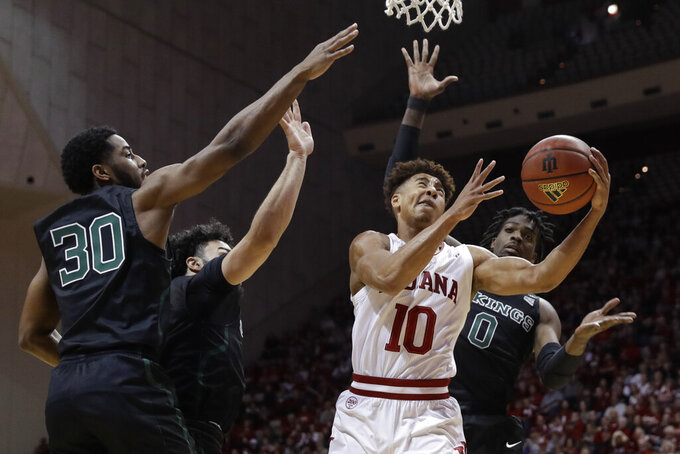 Indiana's Rob Phinisee (10) puts up a shot against Portland State's Chris Whitaker (30), Markus Golder (2) and Sal Nuhu (0) during the first half of an NCAA college basketball game, Saturday, Nov. 9, 2019, in Bloomington, Ind. (AP Photo/Darron Cummings)