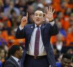 Duke coach Mike Krzyzewski signals to his players during the second half of an NCAA college basketball game against Syracuse in Syracuse, N.Y., Saturday, Feb. 23, 2019. Duke won 75-65. (AP Photo/Nick Lisi)