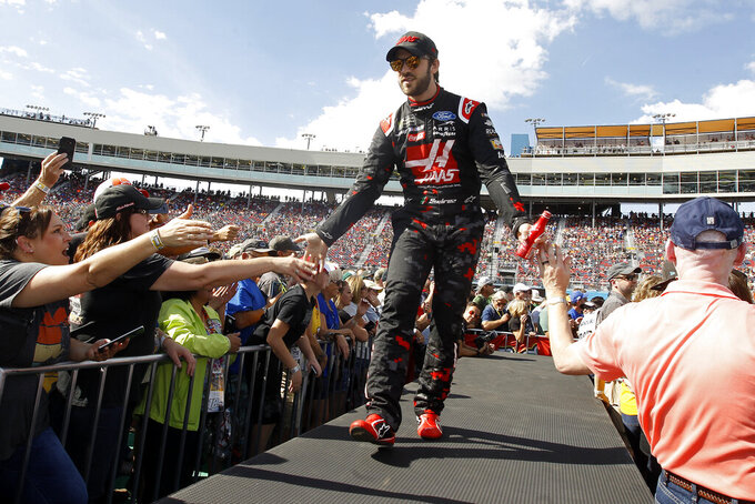 Daniel Suarez greets fans during driver introductions prior to the NASCAR Cup Series auto race at ISM Raceway, Sunday, Nov. 10, 2019, in Avondale, Ariz. (AP Photo/Ralph Freso)