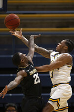 California guard Paris Austin (3) shoots around Colorado guard McKinley Wright IV (25) during the first half of an NCAA college basketball game Thursday, Feb. 27, 2020, in Berkeley, Calif. (AP Photo/D. Ross Cameron)