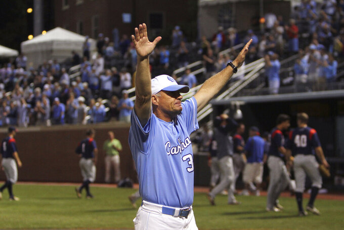 FILE - In this June 3, 2013, file photo, North Carolina head baseball coach Mike Fox celebrates his team's 12-11 win in 13 innings over Florida Atlantic during an NCAA college regional championship baseball game in Chapel Hill, N.C. UNC announced Friday that Fox would retire after 22 seasons at his alma mater that included seven trips to the College World Series. Longtime assistant Scott Forbes is taking over the program. (AP Photo/Ted Richardson, File)
