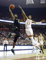 Baylor forward Flo Thamba (0) drives to the basket against Texas guard Jase Febres (13) during the first half on an NCAA college basketball game Wednesday, Feb. 6, 2019, in Austin, Texas. (AP Photo/Eric Gay)