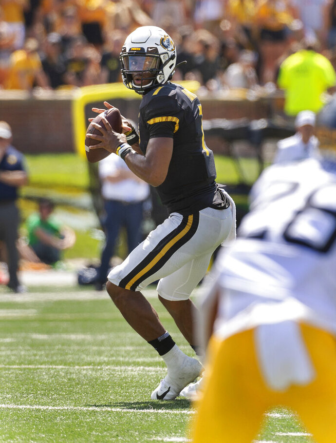 Missouri quarterback Kelly Bryant looks to pass during the first half of an NCAA college football game against West Virginia Saturday, Sept. 7, 2019, in Columbia, Mo. (AP Photo/L.G. Patterson)