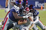 New Mexico State quarterback Josh Adkins (14) is tackled by Mississippi defenders during the second half of an NCAA college football game in Oxford, Miss., Saturday, Nov. 9, 2019. (AP Photo/Rogelio V. Solis)