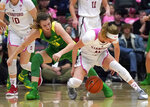Stanford forward Lexie Hull, right, steals the ball from Oregon guard Sabrina Ionescu, left, during the second half of an NCAA college basketball game Sunday, Feb. 10, 2019, in Stanford, Calif. (AP Photo/Tony Avelar)