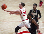 Nebraska guard Thorir Thorbjarnarson (34) drives to the basket against Purdue's Aaron Wheeler (1) and Eric Hunter Jr. (2) during the first half of an NCAA college basketball game on Saturday, Feb. 20, 2021, in Lincoln, Neb. (Francis Gardler/Lincoln Journal Star via AP)