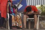 Relatives of a person who died of COVID-19 mourn outside a field hospital in Mumbai, India, Monday, May 3, 2021. (AP Photo/Rafiq Maqbool)