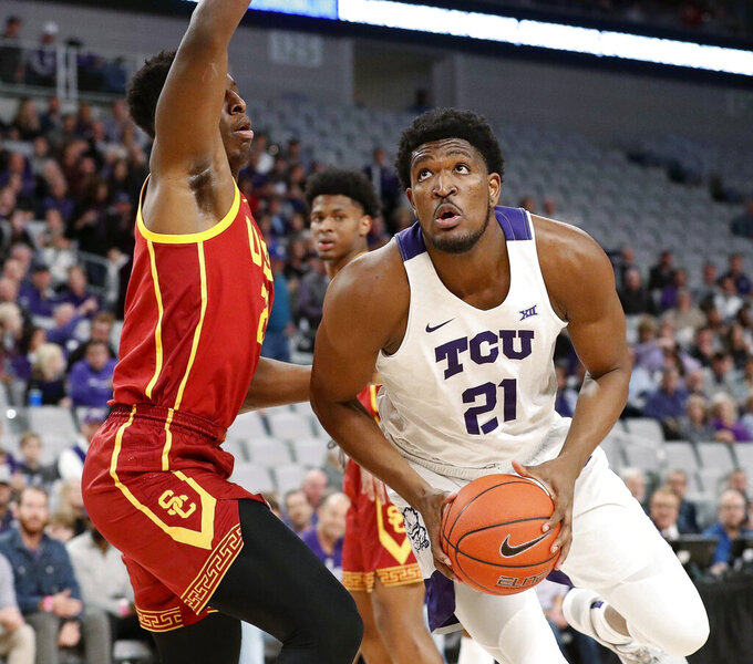 FILE  - TCU guard Kevin Samuel (21) looks to the basket as Southern California forward Onyeka Okongwu, left, defends during the first half of an NCAA college basketball game in Fort Worth, Texas, in this Friday, Dec. 6, 2019, file photo. TCU coach Jamie Dixon isn't expecting center Kevin Samuel and guard RJ Nembhard to play more minutes this season. The team's only returning starters just need to be more efficient when on the court. (Bob Booth/Star-Telegram via AP, File)