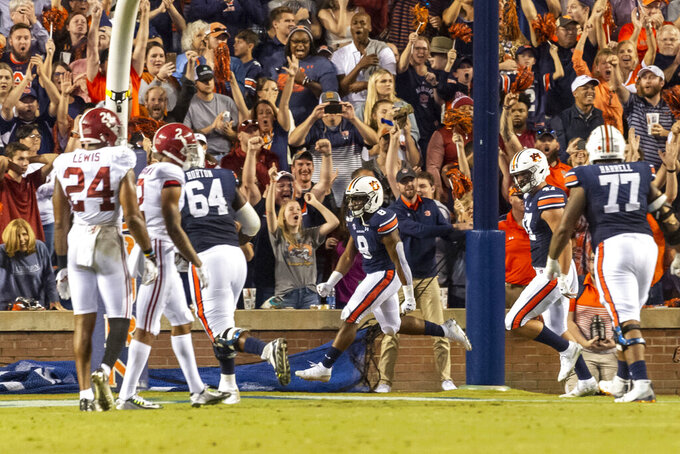 Auburn running back Shaun Shivers (8) celebrates his touchdown run late in the second half of an NCAA college football game against Alabama, Saturday, Nov. 30, 2019, in Auburn, Ala. (AP Photo/Vasha Hunt)