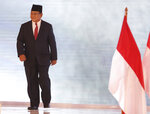 Indonesian presidential candidate Prabowo Subianto walks during a televised debate in Jakarta, Indonesia, Sunday, Feb. 17, 2019. Indonesia is gearing up to hold its presidential election on April 17 that will pit in the incumbent against the former general. (AP Photo / Achmad Ibrahim)