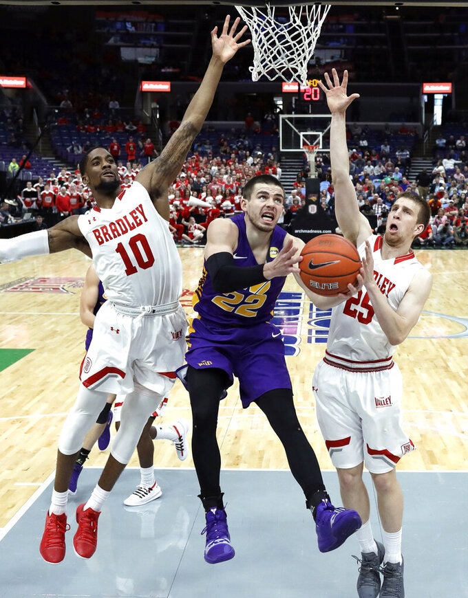 Northern Iowa's Wyatt Lohaus (22) heads to the basket as Bradley's Elijah Childs (10) and Nate Kennell (25) defend during the second half of an NCAA college basketball game in the championship of the Missouri Valley Conference tournament, Sunday, March 10, 2019, in St. Louis. Bradley won 57-54. (AP Photo/Jeff Roberson)